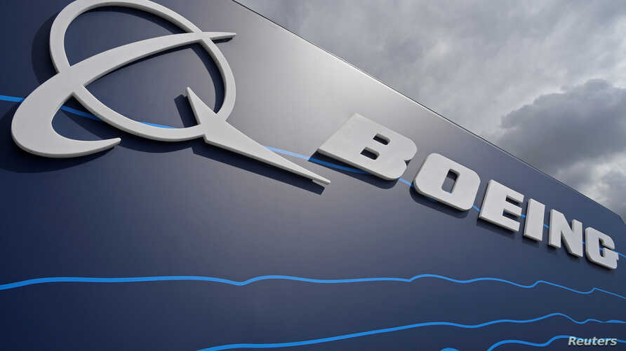 Signage for Boeing is seen on a trade pavilion at Farnborough International Airshow in Farnborough, Britain, July 17, 2018.