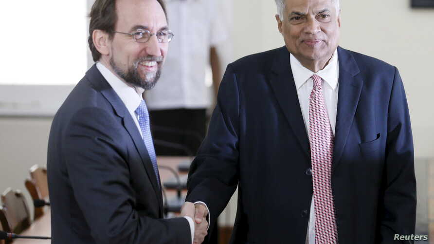 FILE - U.N. High Commissioner for Human Rights Zeid Ra'ad Al Hussein, left, shakes hands with Sri Lankan Prime Minister Ranil Wickremesinghe during their meeting in Colombo, Feb. 9, 2016. The human rights chief was assessing the country's progress in