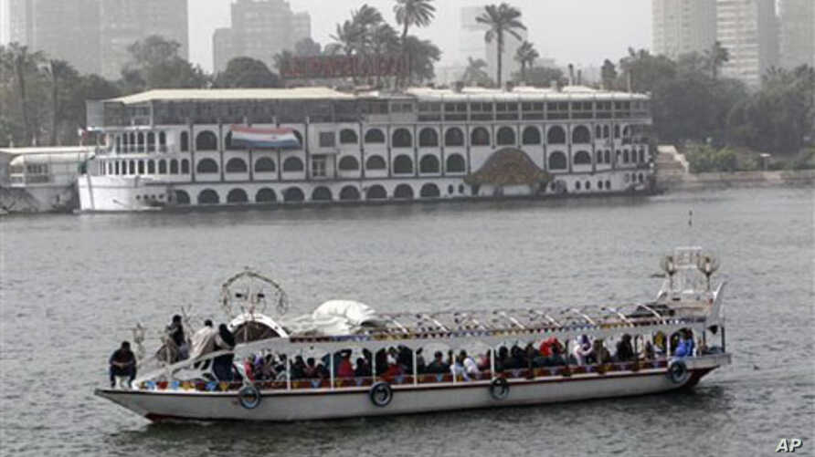 Egyptians enjoy a ride along the Nile river, February 15, 2011