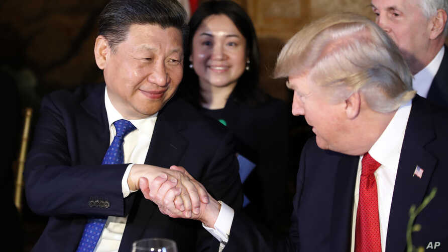 President Donald Trump shakes hands with Chinese President Xi Jinping during a dinner at Mar-a-Lago, April 6, 2017, in Palm Beach, Fla.