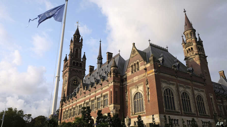 A United Nations flag flutters in the wind next to the International Court of Justice in the Hague, the Netherlands, Aug. 27, 2018. Iran is pressing the court to have U.S. sanctions against Tehran lifted.