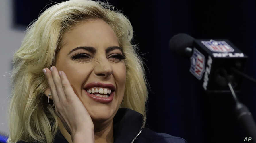 Lady Gaga answers questions at a news conference in Houston NFL Super Bowl LI, Feb. 2, 2017.