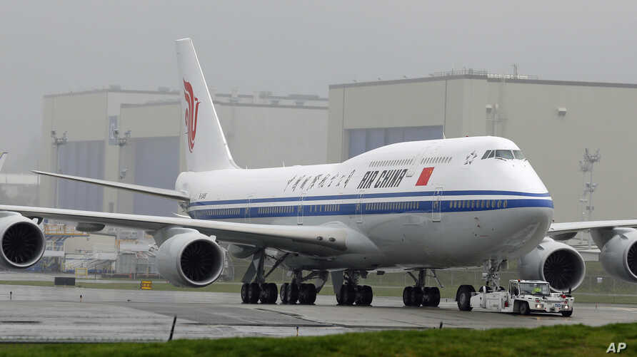 FILE -- In this Sept. 29, 2014, file photo, the first Boeing 747-8 Intercontinental airplane to be delivered to Air China is moved into position from Boeing's assembly facility to Paine Field in Everett, Wash.