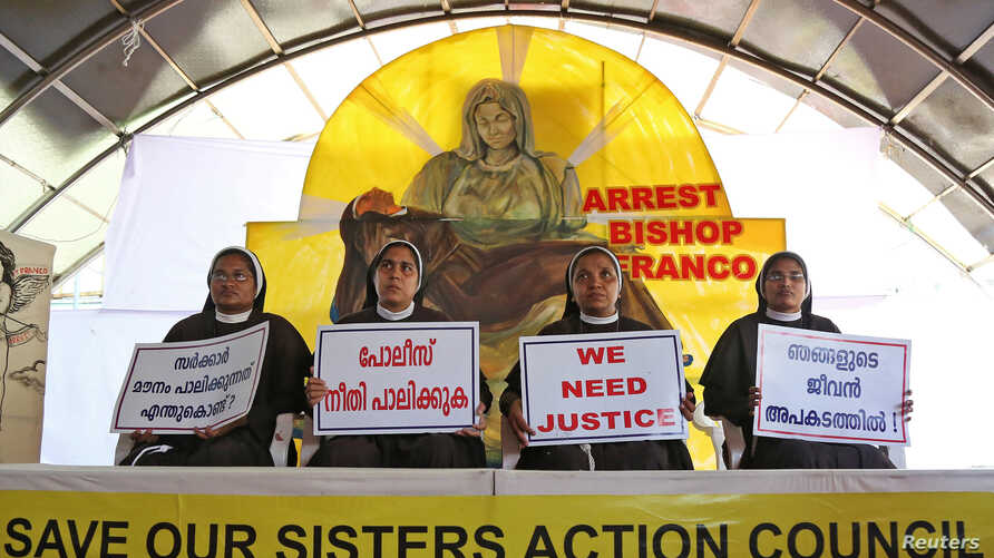 Nuns hold placards during a protest demanding justice after an alleged sexual assault of a nun by a bishop in Kochi, in the southern state of Kerala, India, Sept. 13, 2018.