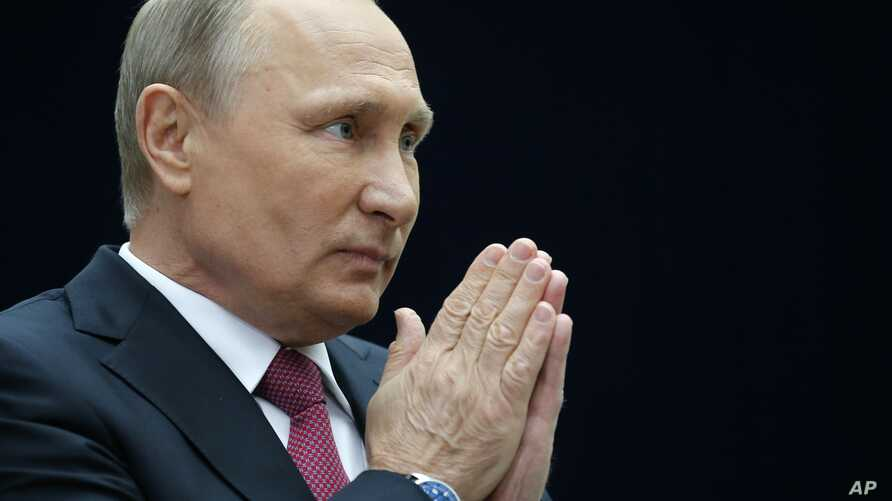 Russian President Vladimir Putin gestures speaking to the media after his annual live call-in show in Moscow, Russia, June 15, 2017.