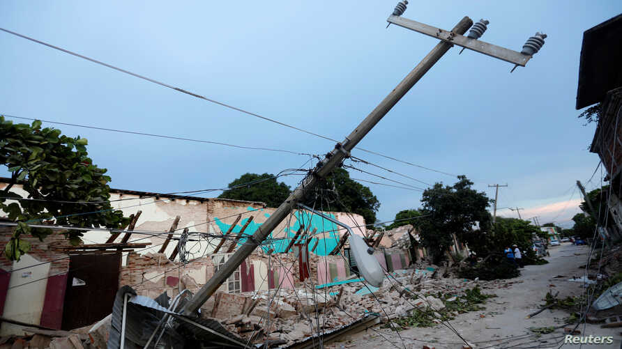 Buildings destroyed by an earthquake that struck off the southern coast of Mexico late on Thursday are seen on a street in Juchitan, Mexico, Sept. 8, 2017.
