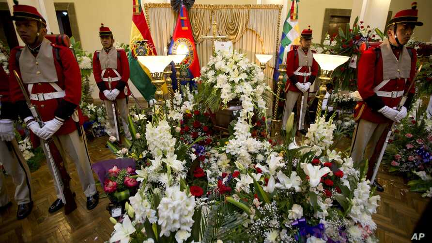 An honor guard stands vigil over Bolivia's Deputy Minister of Internal Affairs Rodolfo Illanes lying in state, inside the government palace in La Paz, Aug. 26, 2016.