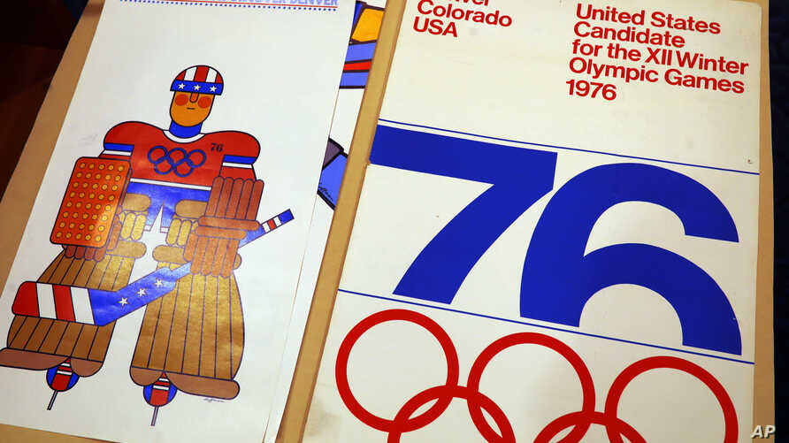 In this Feb. 1, 2018, photograph, one of the posters used in Colorado's effort to secure an Olympic bid in 1976 is part of the memorabilia collection of the Denver Public Library in Denver.