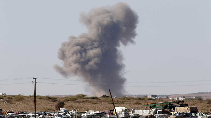 Smoke rises from the Syrian town of Kobani after an air strike, seen from Suruc, Turkey, Oct. 7, 2014.