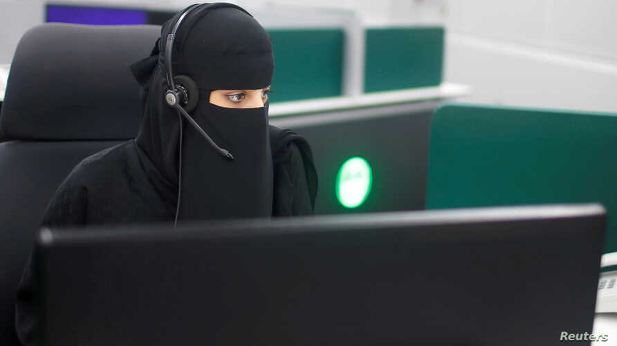 A Saudi woman works inside the first all-female call center in the kingdom's security sector, in the holy city of Mecca, Saudi Arabia, Aug. 29, 2017