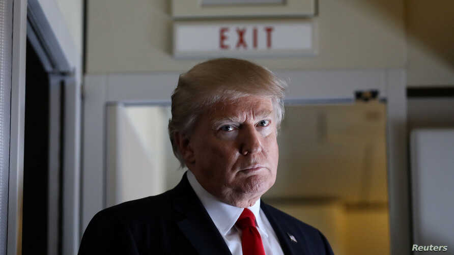 U.S. President Donald Trump pauses as he talks to journalists who are members of the White House travel pool on board Air Force One during his flight to Palm Beach, Florida, Feb. 3, 2017.