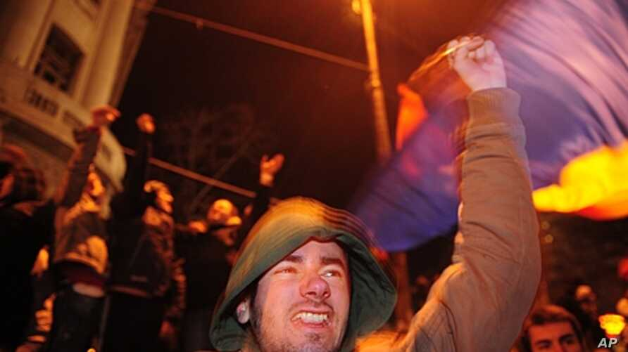 A protester shouts anti-presidential slogans in Piata Universitatii Square, Bucharest, Romania, January 19, 2012.