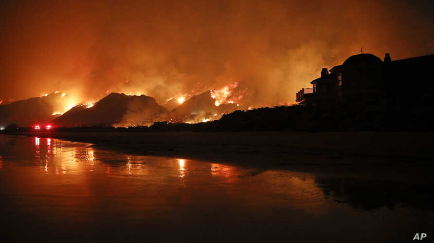 FILE - A wildfire burns along the 101 freeway in Ventura, Calif., Dec. 5 2017. State fire officials said Friday that the Thomas fire has scorched 273,400 acres, or about 427 square miles of coastal foothills and national forest.