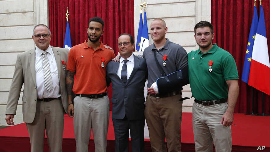 From the left, British businessman Chris Norman,  Anthony Sadler, a senior at Sacramento University in California, French President Francois Hollande, U.S. Airman Spencer Stone, and Alek Skarlatos a U.S. National Guardsman from Roseburg, Oregon pose ...