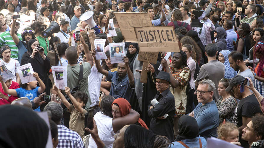 People gather outside Kensington Town Hall during protests following the Grenfell Tower fire in London, June 16, 2017.