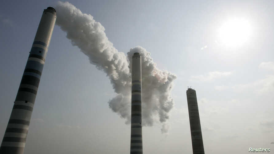 FILE - View of smokestacks, about 200m (656 feet) high, at a thermal power plant in Inchon, west of Seoul, Feb. 1, 2007.