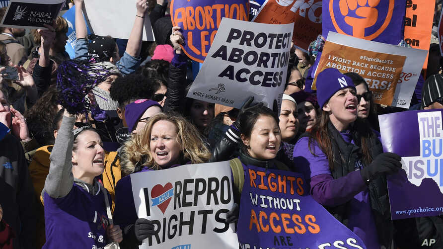Pro-abortion rights protesters rally outside the Supreme Court in Washington, March 2, 2016. The abortion debate is returning to the Supreme Court in the midst of a raucous presidential campaign and less than three weeks after Justice Antonin Scalia'