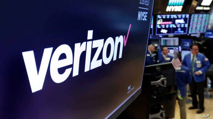 FILE- This April 23, 2018, file photo shows the logo for Verizon above a trading post on the floor of the New York Stock Exchange. Cellular companies such as Verizon are looking to challenge traditional cable companies with residential internet servi