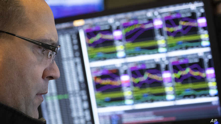 Anthony Matesic, a designated market maker, follows stock prices at the New York Stock Exchange, Dec. 10, 2018.