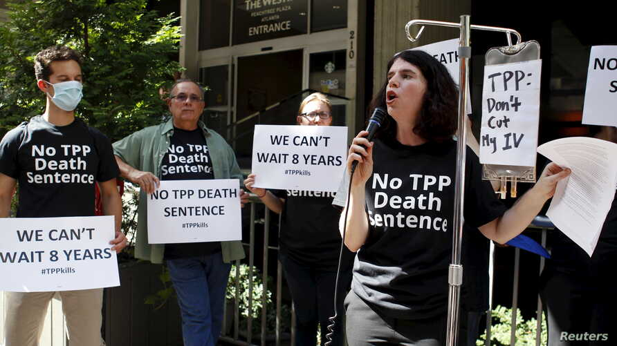 Melinda St. Louis speaks against restriction of access to affordable medicines during a protest outside the hotel where the Trans-Pacific Partnership Ministerial Meetings are being held in Atlanta, Sept. 30, 2015.