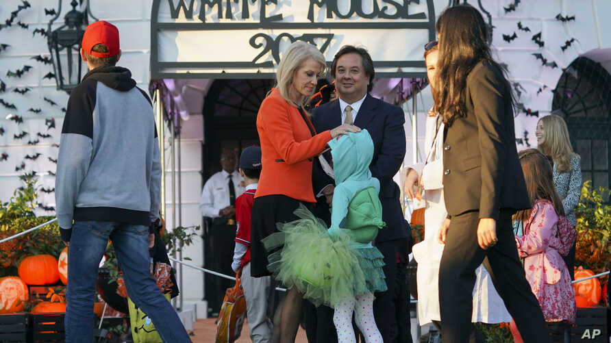 FILE - Counselor to the President Kellyanne Conway and her husband George Conway greet guests on the South Lawn of the White House during a Halloween event welcoming children to trick-or-treat, Oct. 30, 2017.