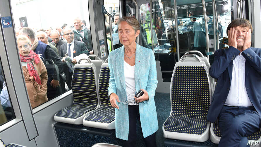 French Minister of Ecological and Inclusive Transition Nicolas Hulot, right, sits in a tram next to French Minister of Transport Elisabeth Borne, center, upon arrival in Bordeaux after the inauguration of a new TGV high-speed train line linking Paris