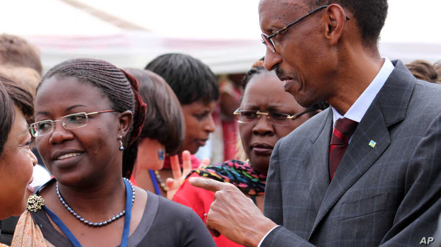 Rwandan President Paul Kagame meets with participants at a conference on the role of women at the nation's parliament, in Kigali, Rwanda, May 2010.