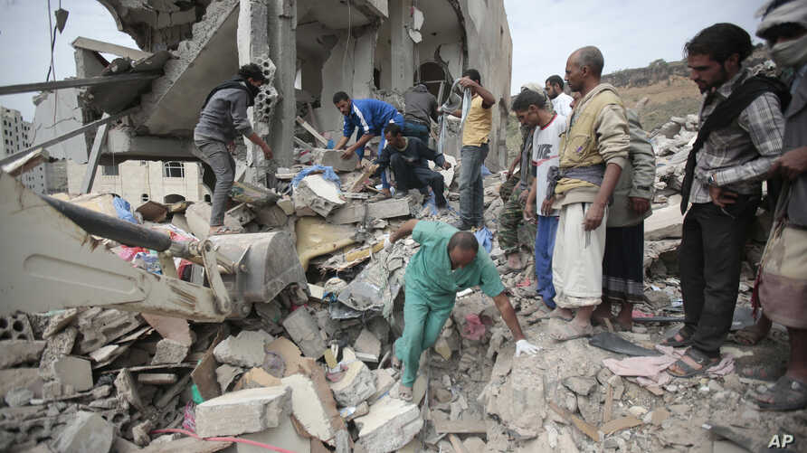 People inspect the rubble of houses destroyed by Saudi-led airstrikes in Sanaa, Yemen, on Friday, Aug. 25, 2017. Airstrikes by a Saudi-led coalition targeted Yemen's capital early Friday, hitting at least three houses in Sanaa and killing dozens of c...