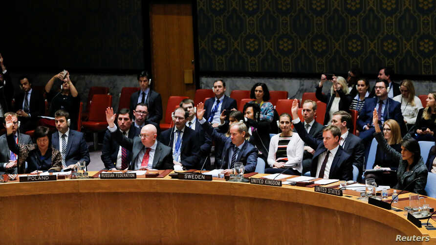 Members of the U.N. Security Council vote for cease-fire to Syrian bombing in eastern Ghouta, at U.N. headquarters in New York, Feb.  24, 2018.