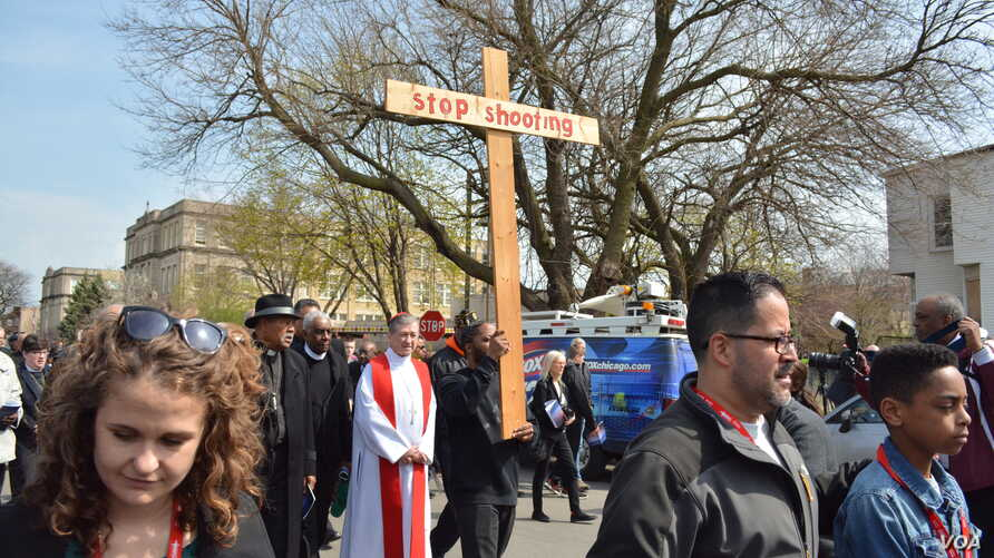 Cardinal Blase Cupich of the Roman Catholic Archdiocese of Chicago leads a prayer walk for peace through the Englewood neighborhood, which is regularly the scene of gun violence, Chicago's South Side, April 14, 2017.