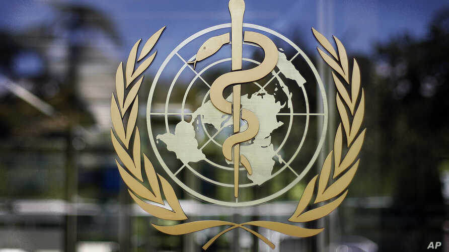 FILE - The logo of the World Health Organization is seen at the WHO headquarters in Geneva, Switzerland.
