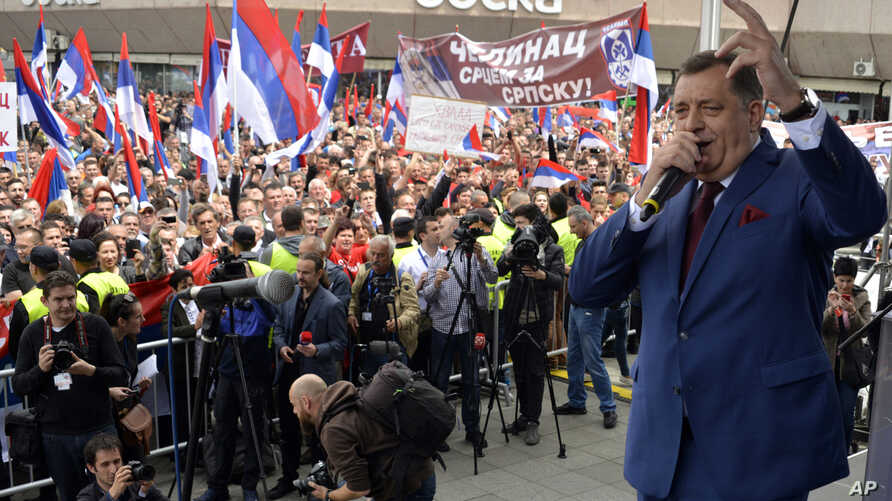 FILE - Milorad Dodik, president of the Bosnian Serb region of Republic of Srpska, sings song during a political protest in the Bosnian town of Banja Luka, 240 kilometers northwest of the Bosnian capital of Sarajevo, May. 14, 2016.