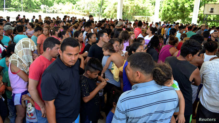 A general view shows migrants from Central America and Cuba waiting to be registered for humanitarian visas to cross the country on their way to the United States, in Acacoyagua, in Chiapas state, Mexico, March 27, 2019.