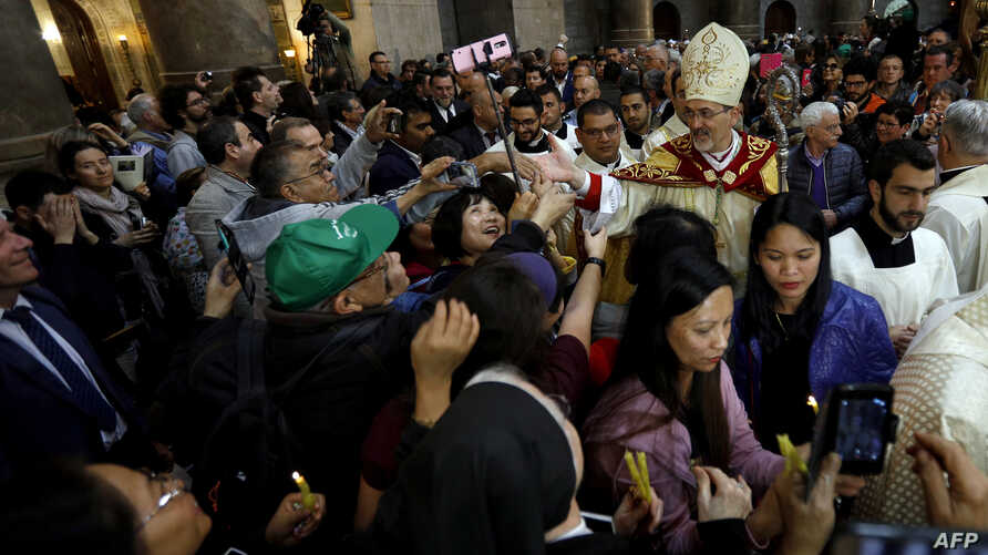 The head of the Roman Catholic Church in the Holy Land, Apostolic Administrator of the Latin Patriarchate Pierbattista Pizaballa leads the Easter Sunday procession on Apr. 1, 2018 at the Church of the Holy Sepulchre, traditionally believed to be the