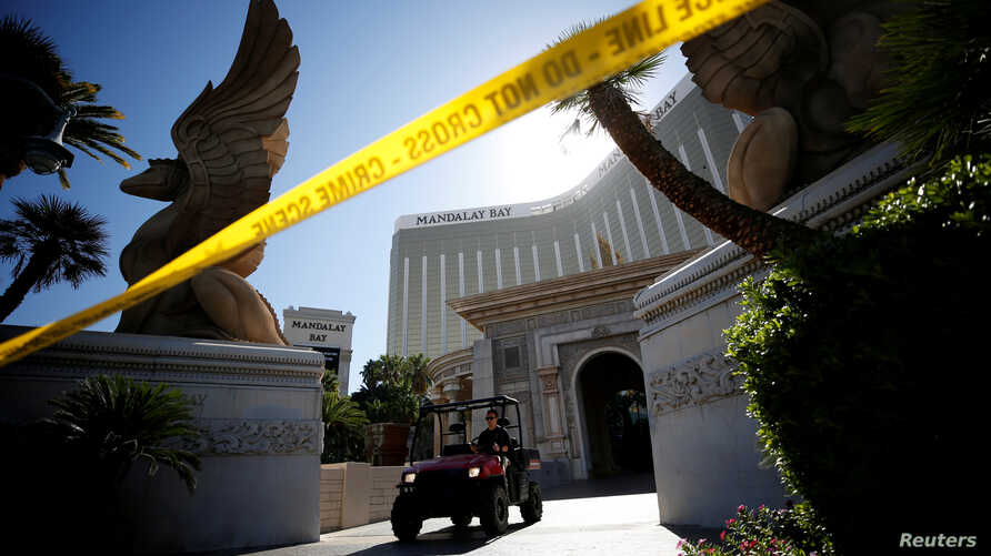 A member of the FBI leaves the Mandalay Bay Resort and Casino, from which Stephen Paddock shot and killed 58 people and wounded hundreds more on Oct. 1, in Las Vegas, Nevada, Oct. 4, 2017.