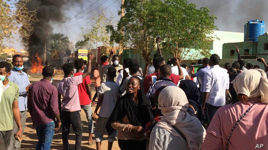 Anti-government protesters rally in Khartoum, Sudan, Sunday, Jan. 13, 2019.