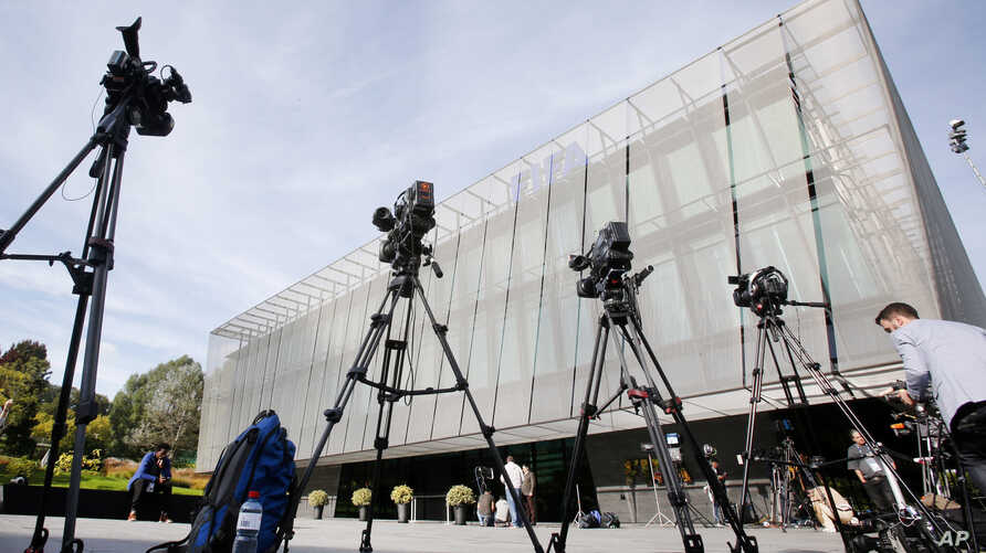 FILE - TV cameras stand outside the FIFA headquarters after a meeting of the FIFA Executive Committee in Zurich, Switzerland, Sept. 25, 2015.