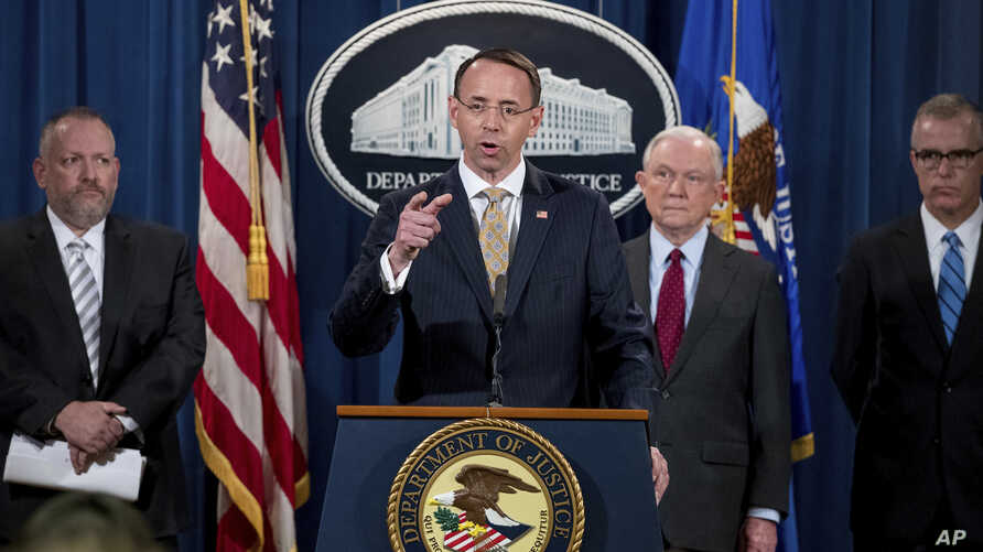 Deputy Attorney General Rod Rosenstein, center, accompanied by DEA Deputy Administrator Robert Patterson, left, Attorney General Jeff Sessions, second from right, and FBI Acting Director Andrew McCabe, right, speaks at a news conference to announce a...