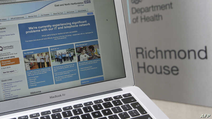 This photograph, posed as an illustration on May 12, 2017, shows the website of the NHS: East and North Hertfordshire notifying users of a problem in its network taken outside the Department of Health in London.