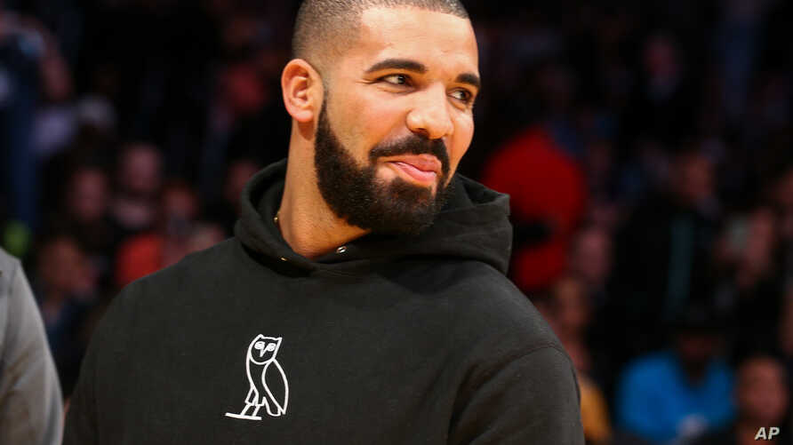 FILE - Drake attends an NBA game.