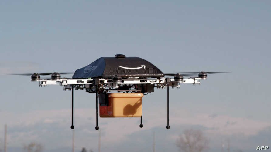 "This undated handout photo released by Amazon on December 1, 2013 shows a flying ""octocopter"" mini-drone that would be used to fly small packages to consumers. Amazon CEO Jeff Bezos revealed on December 1 that his company was looking to the future wi"