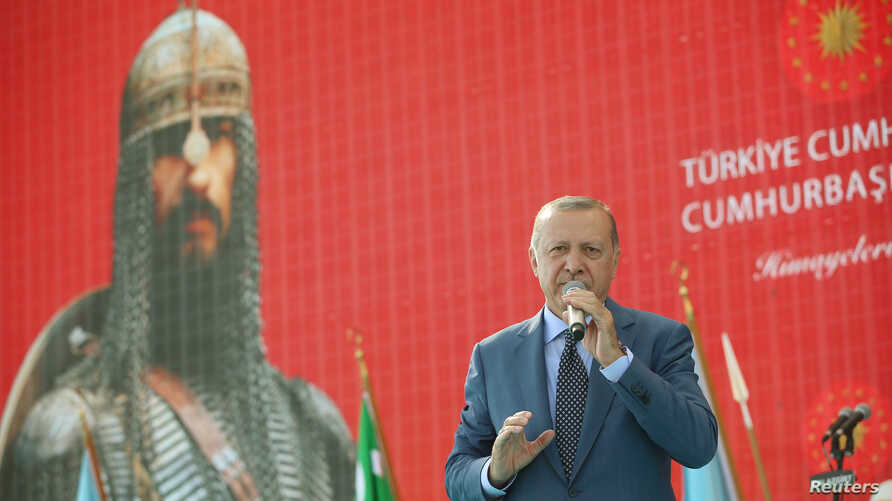 Turkish President Tayyip Erdogan makes a speech during a ceremony in the eastern city of Mus, Turkey August 26, 2018.
