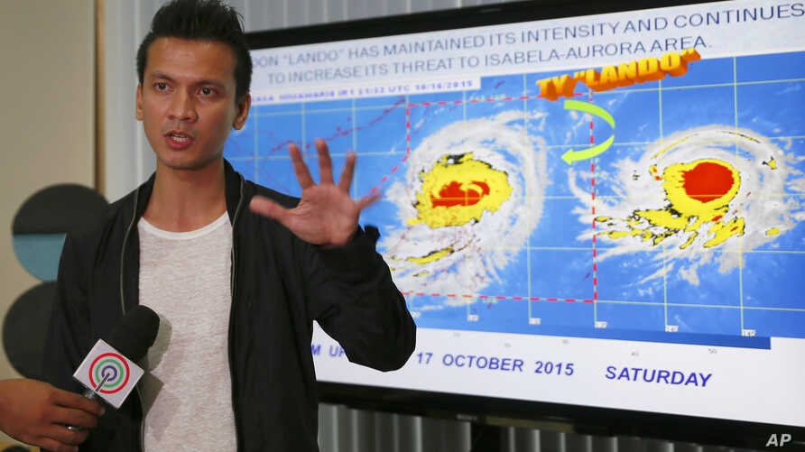 Weather Bureau forecaster Aldczar Aurelio gestures during a media briefing on Typhoon Koppu, Oct. 17, 2015 at suburban Quezon city, northeast of Manila, Philippines.