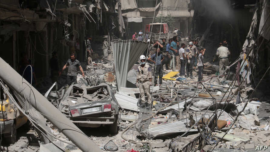 Destruction is seen following a reported barrel-bomb attack by Syrian government forces in the northern city of Aleppo on June 26, 2014.