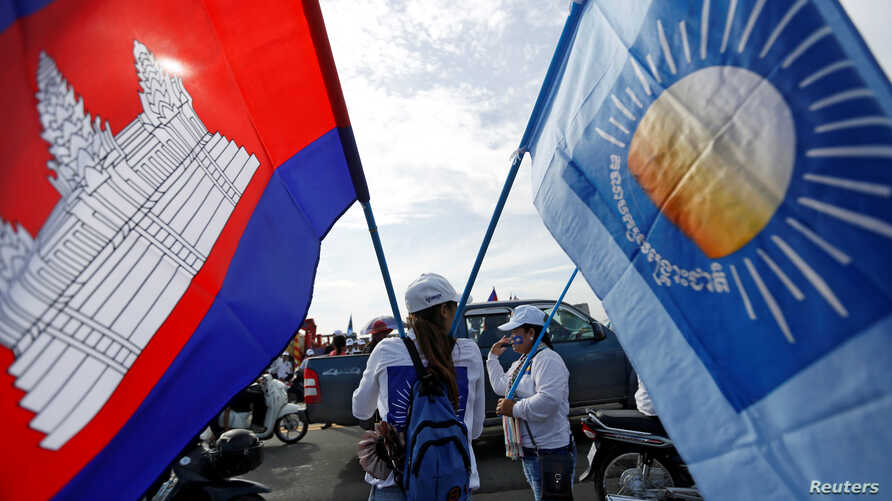 Supporters of the Cambodia National Rescue Party (CNRP) gather during a local election campaign in Phnom Penh, Cambodia May 20, 2017.