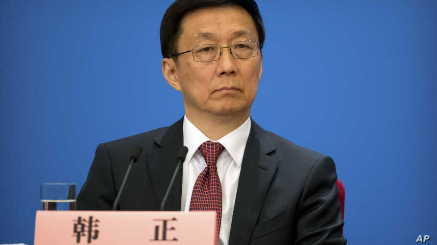 Vice Premier Han Zheng attends a press conference after the closing session of China's National People's Congress (NPC) at the Great Hall of the People in Beijing, Tuesday, March 20, 2018.