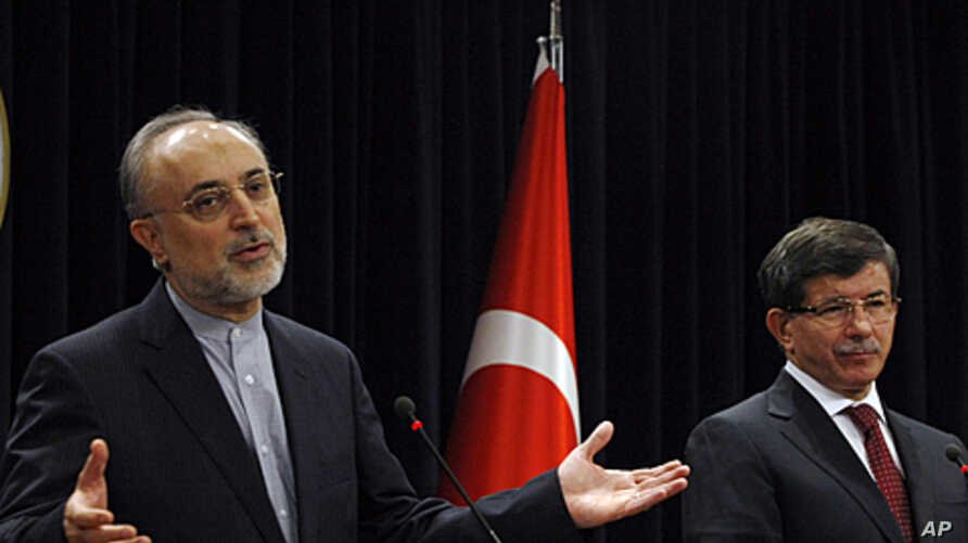 Turkish Foreign Minister Ahmet Davutoglu, right, and his Iranian counterpart Ali Akbar Salehi speak to the media after talks in Ankara, Turkey, October 21, 2011.