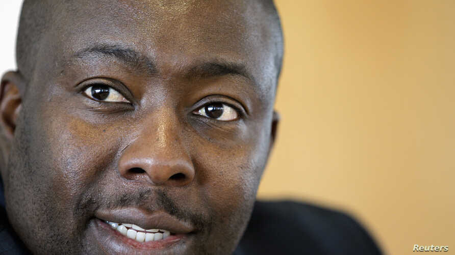 FILE - Zimbabwe's Minister of Youth Development, Indigenization and Empowerment Saviour Kasukuwere speaks during the Reuters Africa Investment Summit in Sandton, April 16, 2012.