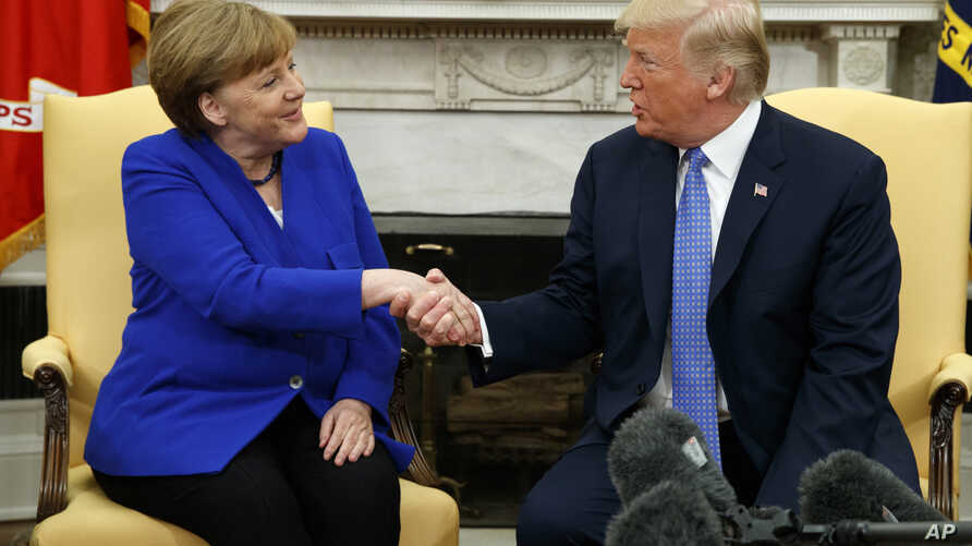 President Donald Trump meets with German Chancellor Angela Merkel in the Oval Office of the White House,  April 27, 2018, in Washington.