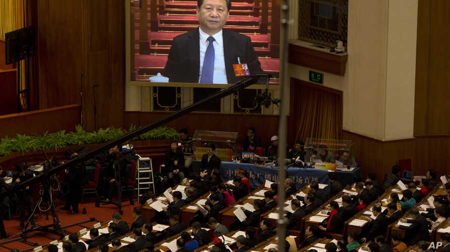 Chinese President Xi Jinping is displayed on a large screen during the opening session of the annual National People's Congress in Beijing's Great Hall of the People, March 5, 2016.